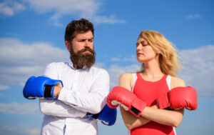 man and woman with boxing gloves on reconciling