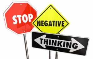 "signs with words, ""stop negative thoughts"""